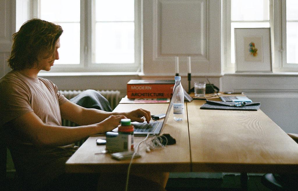 man-sitting-while-using-laptop